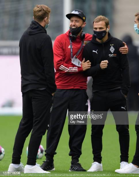 Christoph Kramer of Borussia Moenchengladbach Max Kruse of 1FC Union Berlin and Tony Jantschke of Borussia Moenchengladbach before the game between...