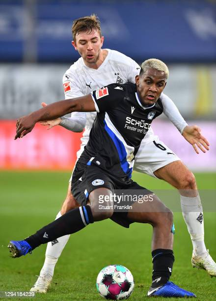 Christoph Kramer of Gladbach is challenged by Sergio Córdova of Bielefeld during the Bundesliga match between DSC Arminia Bielefeld and Borussia...