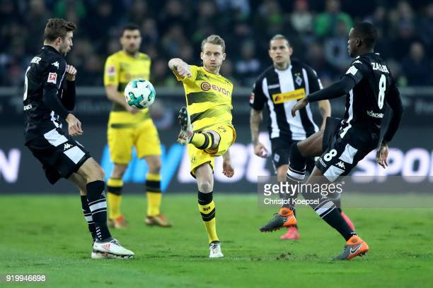 Christoph Kramer of Moenchengladbach and Denis Zakaria of Moenchengladbach challenge Andre Schuerrle of Dortmund during the Bundesliga match between...