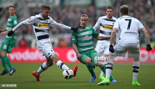 Christoph Kramer of Moenchengladbach and Max Kruse of Werder Bremen Patrick Herrmann of Moenchengladbach battle for the ball during the Bundesliga...