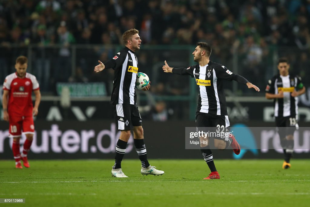 Christoph Kramer of Moenchengladbach (l) and Vincenzo Grifo of Moenchengladbach celebrate after Jannik Vestergaard of Moenchengladbach (not pictured) scored a goal to make it 1:1 during the Bundesliga match between Borussia Moenchengladbach and 1. FSV Mainz 05 at Borussia-Park on November 4, 2017 in Moenchengladbach, Germany.