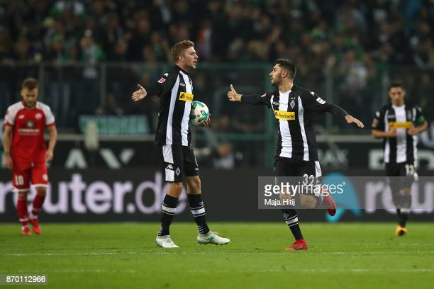Christoph Kramer of Moenchengladbach and Vincenzo Grifo of Moenchengladbach celebrate after Jannik Vestergaard of Moenchengladbach scored a goal to...