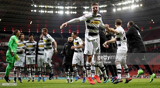 Christoph Kramer of Moenchengladbach celebrates with fans after winning the Bundesliga match between Bayer 04 Leverkusen and Borussia...