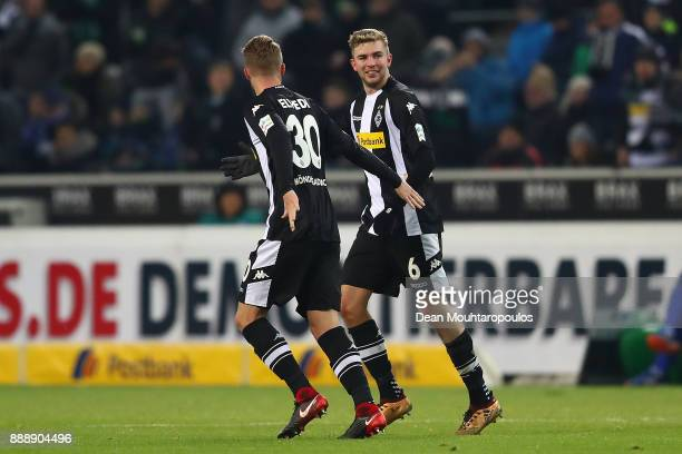 Christoph Kramer of Moenchengladbach celebrates with Nico Elvedi of Moenchengladbach after he scored a goal to make it 10 during the Bundesliga match...