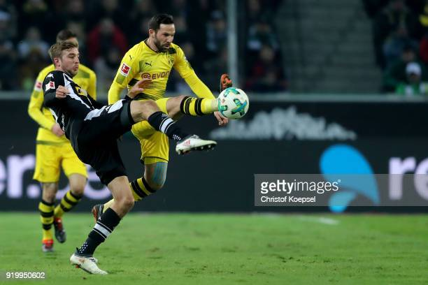 Christoph Kramer of Moenchengladbach challenges Gonzalo Castro of Dortmund during to the Bundesliga match between Borussia Moenchengladbach and...