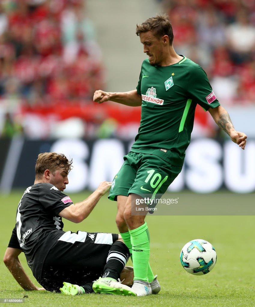 Christoph Kramer of Moenchengladbach challenges Max Kruse of Bremen during the Telekom Cup 2017 match between Borussia Moenchengladbach and Werder Bremen at on July 15, 2017 in Moenchengladbach, Germany.