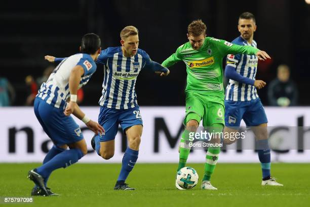 Christoph Kramer of Moenchengladbach fights for the ball with Arne Maier of Berlin during the Bundesliga match between Hertha BSC and Borussia...