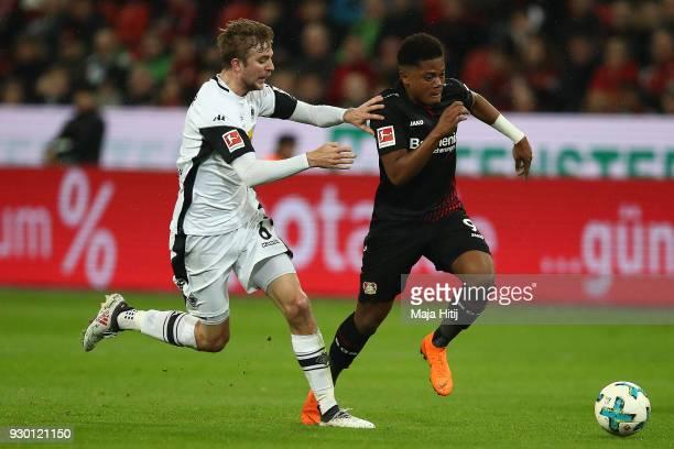 Christoph Kramer of Moenchengladbach fights for the ball with Leon Bailey of Bayer Leverkusen during the Bundesliga match between Bayer 04 Leverkusen...