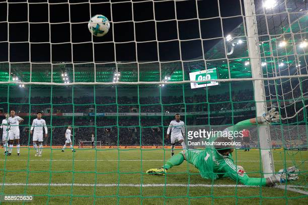 Christoph Kramer of Moenchengladbach scores a goal past goalkeeper Ralf Faehrmann of Schalke to make it 10 during the Bundesliga match between...