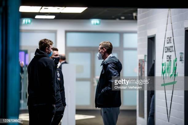 Christoph Kramer Patrick Herrmann of Borussia Moenchengladbach and Andre Hahn of FC Augsburg are seen before the Bundesliga match between Borussia...
