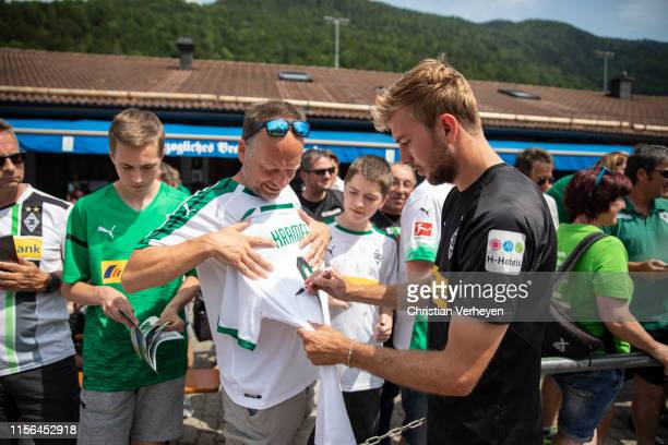 Christoph Kramer sign a fan jersey after a training session at the Borussia Moenchengladbach Training Camp on July 19, 2019 in Rottach-Egern, Germany.