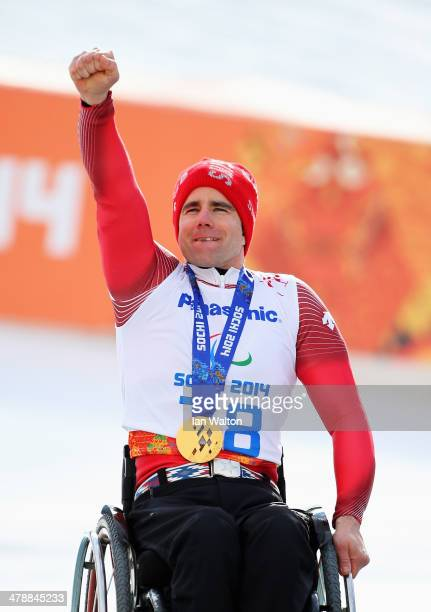 Christoph Kunz of Switzerland celebrates during the medal ceremony for the Men's Giant Slalom Sitting during day eight of the Sochi 2014 Paralympic...