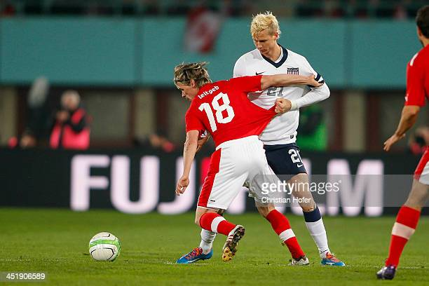 Christoph Leitgeb of Austria competes for the ball with Brek Shea of USA during the International friendly match between Austria and USA at the...
