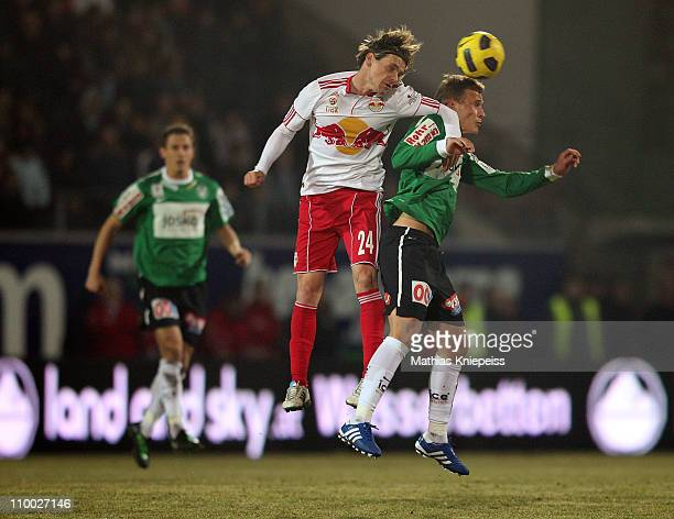 Christoph Leitgeb of Salzburg and Thomas Schrammel of Ried goes up for a header during the tipp3Bundesliga powered by TMobile match between SV Josko...