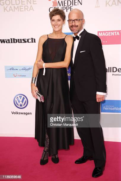 Christoph Maria Herbst and Gisi Herbst attends the Goldene Kamera at Tempelhof Airport on March 30 2019 in Berlin Germany