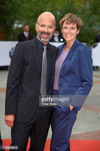 Christoph Maria Herbst and his wife Gisi Herbst arrive at the German Film Award 2019 at Palais am Funkturm on May 3 2019 in Berlin Germany