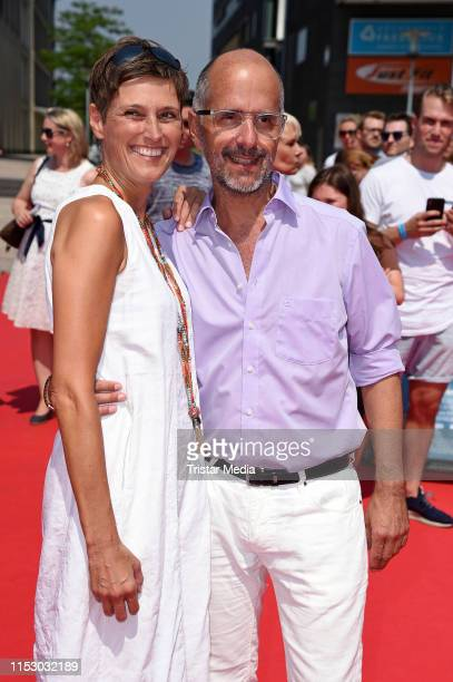 "Christoph Maria Herbst and his wife Gisi Herbst attend the ""Kroos"" world premiere on June 30, 2019 in Cologne, Germany."