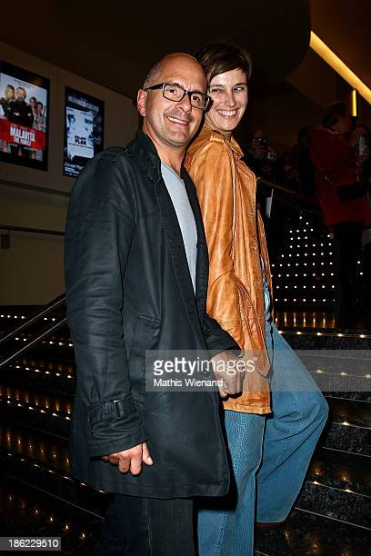 Christoph Maria Herbst and his wife Gisi Herbst attend the premiere of King Ping at Cinemaxx Wuppertal on October 29 2013 in Wuppertal Germany