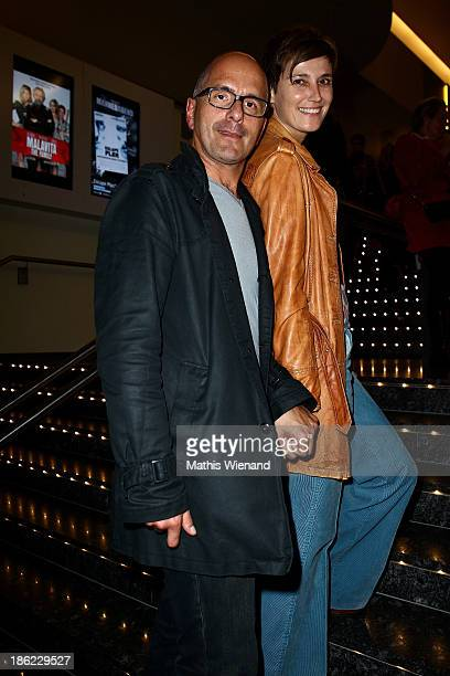 "Christoph Maria Herbst and his wife Gisi Herbst attend the premiere of ""King Ping"" at Cinemaxx Wuppertal on October 29, 2013 in Wuppertal, Germany."