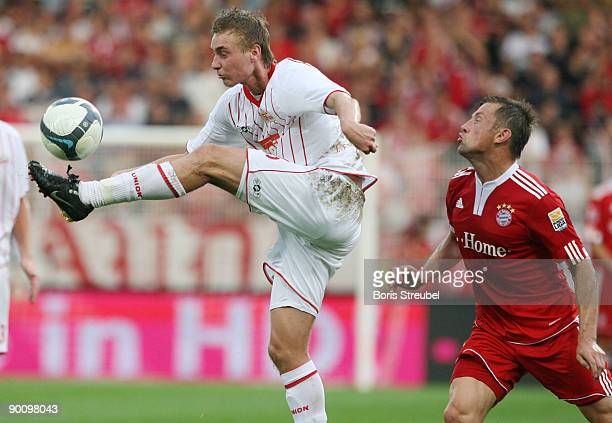 Christoph Menz of Berlin battles for the ball with Ivica Olic of Bayern during the friendly match between 1. FC Union Berlin and FC Bayern Muenchen...