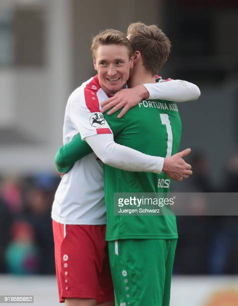 Christoph Menz of Cologne celebrates with Tim Boss after the 3 Liga match between SC Fortuna Koeln and SV Wehen Wiesbaden at Suedstadion on February...