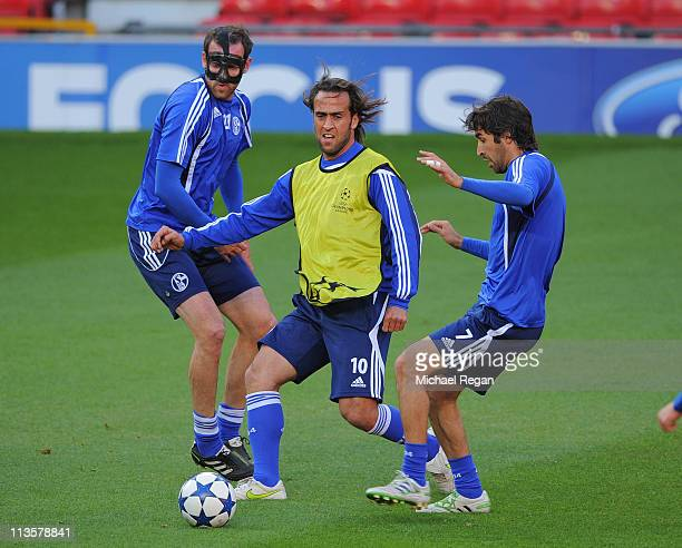 Christoph Metzelder Ali Karimi and Raul in action during a training session ahead of their UEFA Champions League semi final second leg match against...