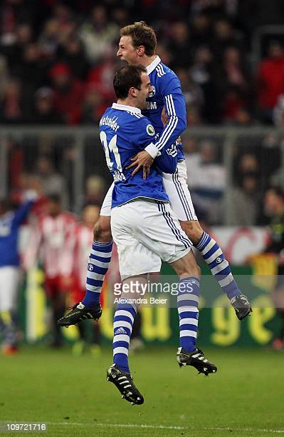 Christoph Metzelder and Benedikt Hoewedes of Schalke celebrate their team's victory of the DFB Cup semi final match between FC Bayern Muenchen and...