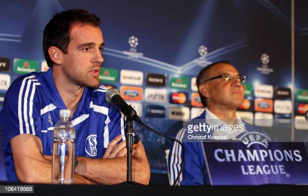 Christoph Metzelder and head coach Felix Magath look on during a FC Schalke 04 press conference ahead of the UEFA Champions League match against...