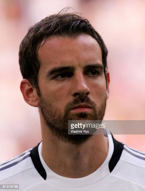 Christoph Metzelder of Germany stands up for the anthems prior to the German international friendly match between Germany and Serbia at the Stadium...
