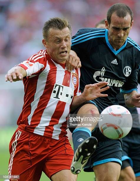 Christoph Metzelder of Schalke and Ivica Olic of Muenchen battle for the ball during the Supercup match between FC Bayern Muenchen and FC Schalke 04...
