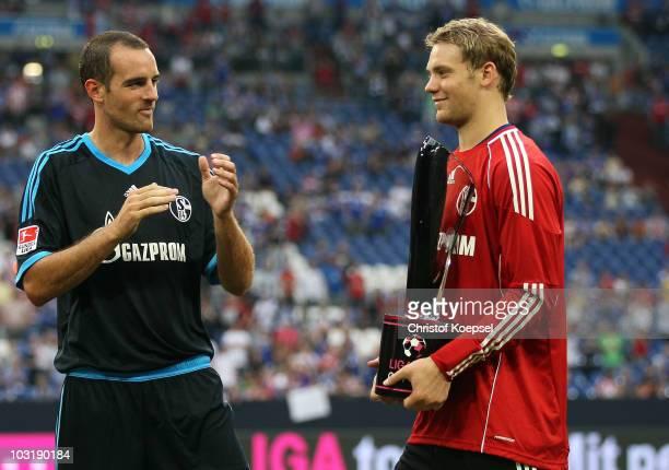 Christoph Metzelder of Schalke applauds Manuel Neuer who holds the winning tropy after winning 3-1 the LIGA total! Cup 2010 final match between FC...