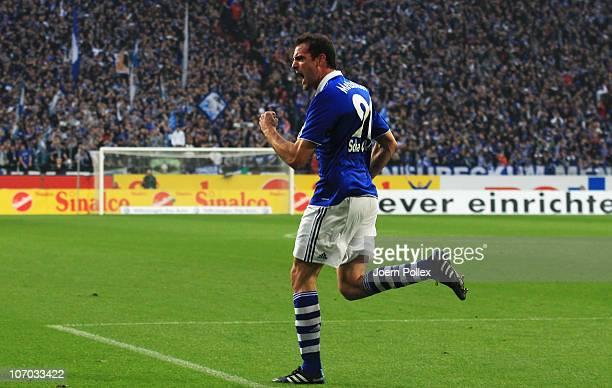 Christoph Metzelder of Schalke celebrates after scoring his team's first goal during the Bundesliga match between FC Schalke 04 and SV Werder Bremen...