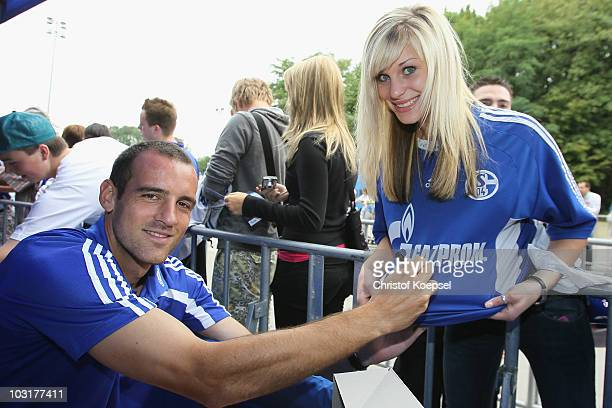 Christoph Metzelder of Schalke writes autographs during the FC Schalke 04 season opening around the Veltins Arena on July 31, 2010 in Gelsenkirchen,...