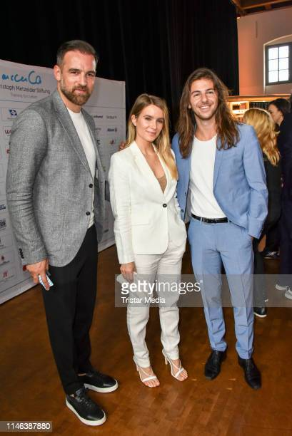 Christoph Metzelder Riccardo Basile and Isabelle during the 11th Golf Charity Cup PreGolf party at Schinkelhalle on May 26 2019 in Potsdam Germany