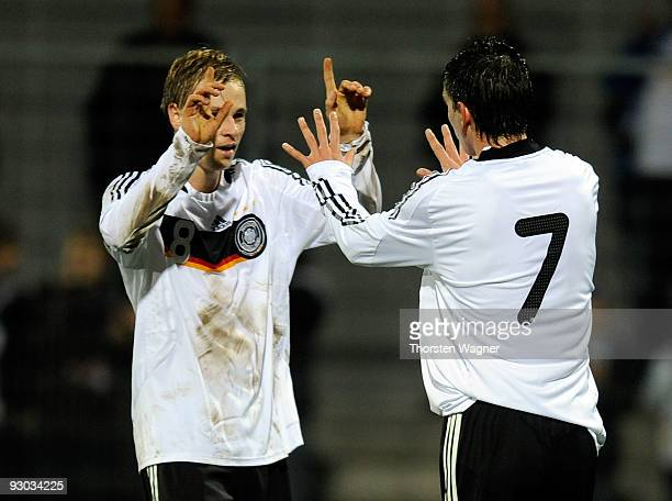 Christoph Moritz of Germany celebrates after scoring the 11 with his team mate Maximilian Beister during the U20 International Friendly match between...