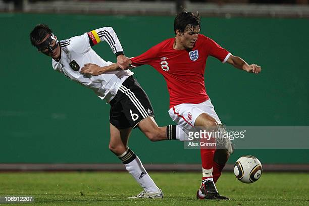 Christoph Moritz of Germany is challenged by Jack Cork of England during the U21 international friendly match between Germany and England at the...