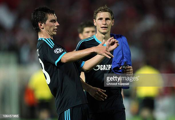 Christoph Moritz of Schalke and Benedikt Hoewedes of Schalke look dejected after the 00 draw of the UEFA Champions League group B match between...