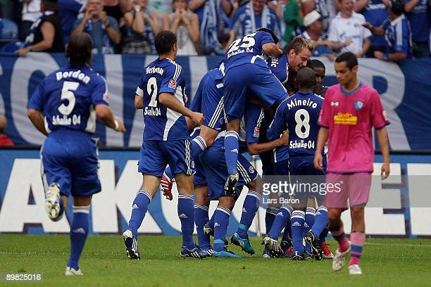 Christoph Moritz of Schalke celebrates with team mates after scoring the first goal during the Bundesliga match between FC Schalke 04 and VfL Bochum...