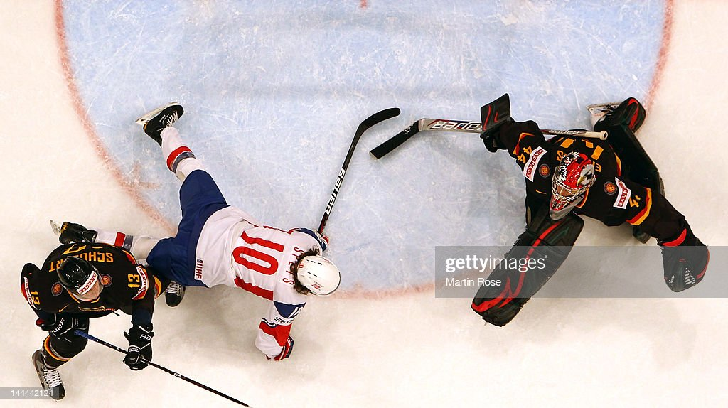 Christoph Schubert (L) of Germany checks Lars Spets (#10) of Norway in front of the net during the IIHF World Championship group S match between Germany and Norway at Ericsson Globe on May 13, 2012 in Stockholm, Sweden.