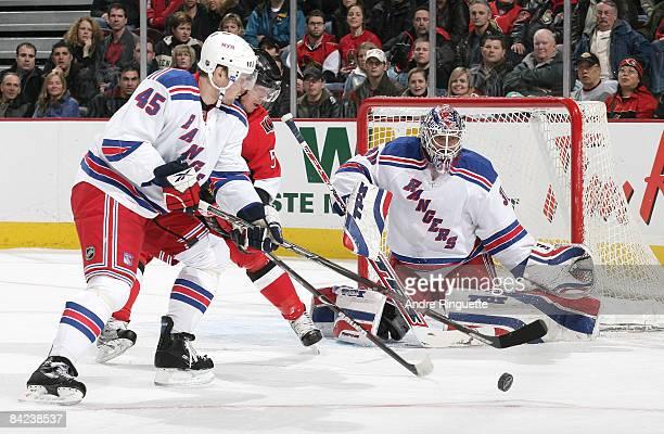 Christoph Schubert of the Ottawa Senators looks for a rebound as Henrik Lundqvist and Dmitri Kalinin of the New York Rangers guard against him at...