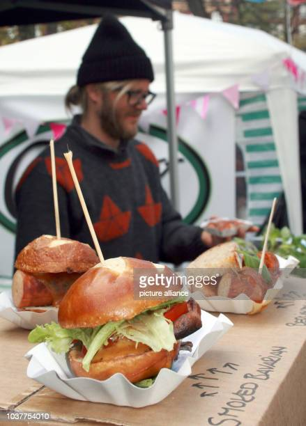 Christoph Schwarz from Germany along with three friends offers 'German Tapas' namely Currywurst and Leberkaese at his food stall during Restaurant...