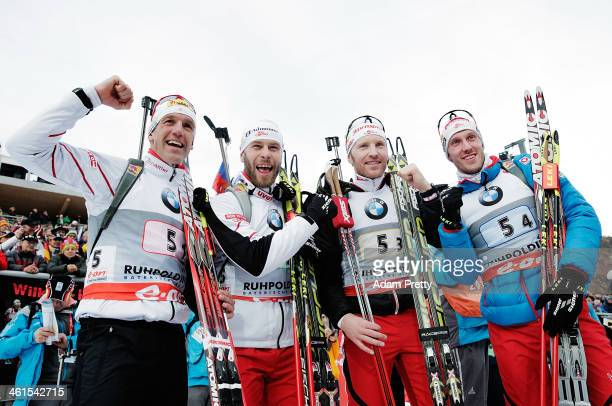 Christoph Sumann Daniel Mesotitsch Simon Eder and Dominik Landertinger of Austria overtakes Simon Schempp of Germany to win the men's 4x75km relay on...