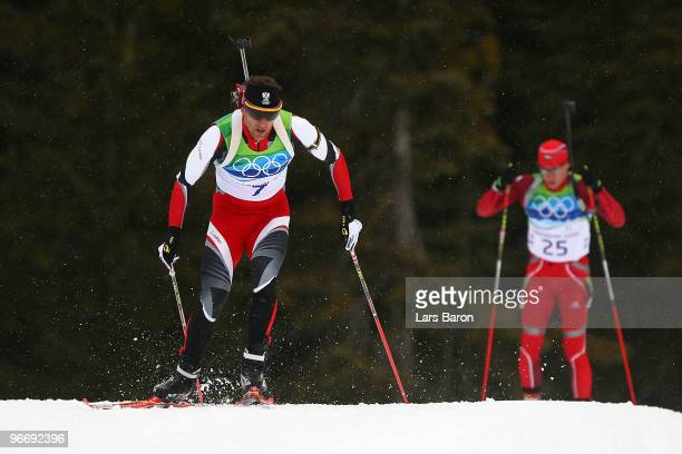 Christoph Sumann of Austria competes against Krasimir Anev of Bulgaria during the Biathlon Men's 10 km Sprint on day 3 of the 2010 Winter Olympics at...