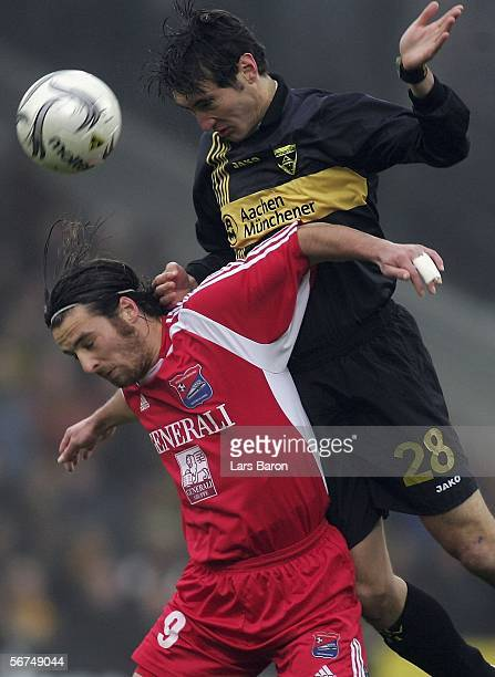 Christoph Teinert of Unterhaching goes up for a header with Mirko Casper of Aachen during the Second Bundesliga match between Alemannia Aachen and...