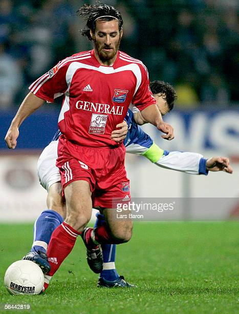 Christoph Teinert of Unterhaching in action with Thomas Zdebel of Bochum during the Second Bundesliga match between VfL Bochum and SpVgg Unterhaching...
