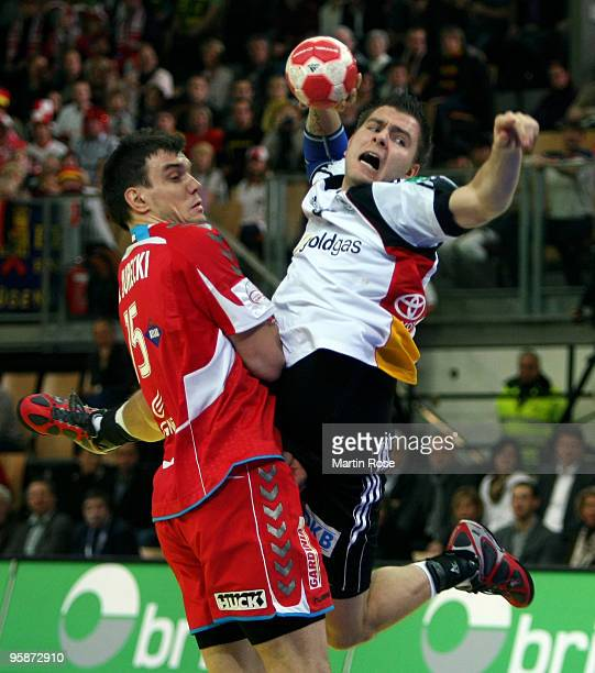 Christoph Theuerkauf of Germany in action with Michal Jurecki of Poland during the Men's Handball European Championship Group C match between Germany...