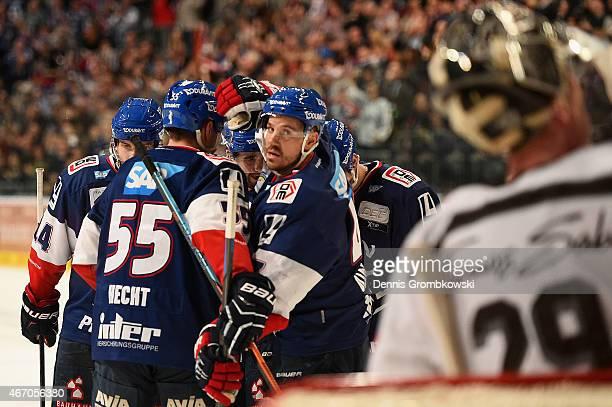 Christoph Ullmann of Adler Mannheim celebrates as he scores their third goal during the DEL Ice Hockey Playoffs Quarter Final Game 5 between Alder...