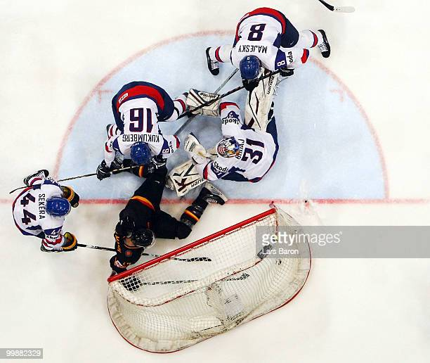 Christoph Ullmann of Germany scores a irregular goal with his foot past goaltender Peter Budaj of Slovakia during the IIHF World Championship...