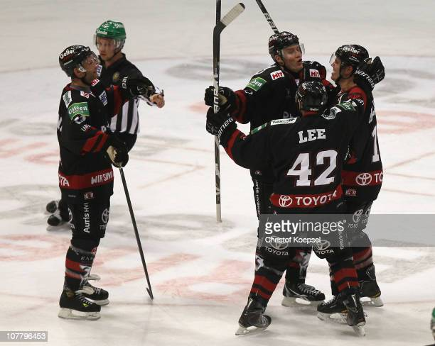 Christoph Ullmann of Koelner Haie celebrates the second goal with Chris Lee of Koelner Haie Daniel Sparre and Mirko Luedemann during the DEL match...