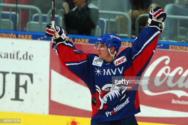 Christoph Ullmann of Mannheim celebrates his team's second goal during the DEL match between Adler Mannheim and Thomas Sabo Ice Tigers at SAP Arena...